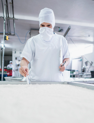 Man in a lab working testing dairies