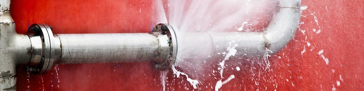 A leaking pipe on a red background.