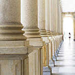 Row of classical columns, Mlynska colonnade Karlovy Vary Czech Republic established 1881, full frame horizontal composition, background with copy space