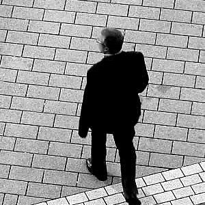 Man walking across pavement