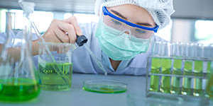 Close-up of a female scientist experimenting in a laboratory.