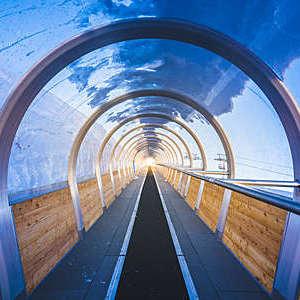Indoor ski lift tunnel with conveyor belt in the Jungfrau region in Switzerland.
